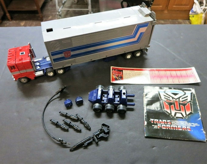 Featured listing image: 1980 1982 Takara Japan G1 Optimus Prime, Gorgeous Chrome, COMPLETE Including Paperwork and Tech Spec!