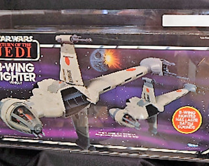 Featured listing image: Vintage AFA 70+ B-Wing Fighter Kenner Star Wars Return of the Jedi MISB