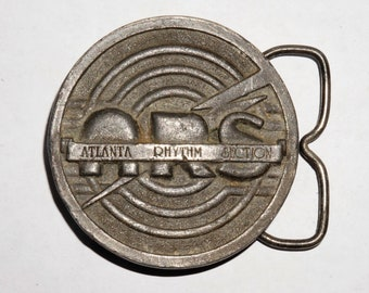 Vintage Atlanta Rhythm Section brass belt buckle 1977