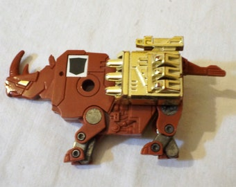 1986 Hasbro G1 Transformers Ramhorn rhinoceros micro cassette complete with GOLD weapons