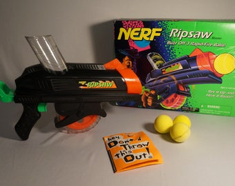 Vintage 1994 NERF Ripsaw Blaster MIB with unused order form and original Nerf ballistic balls