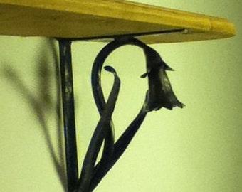 Shelf Brackets  flower sculpture hand forged in Shropshire.