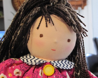 Doll made by hand from 100% wool and cotton.