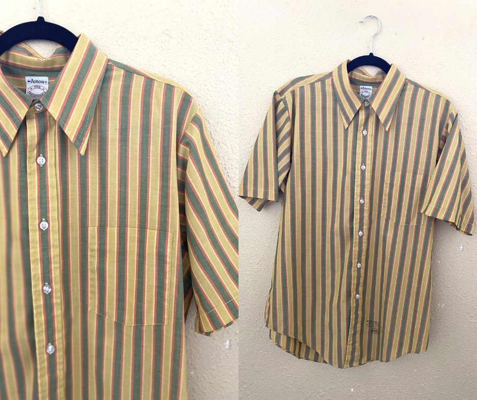 1970s Mens Shirt Styles – Vintage 70s Shirts for Guys 70S Mens Short Sleeve Button Up. 1970S Striped Shirt. Yellow  Green. Medium. Large. The Traditionals Arrow $0.00 AT vintagedancer.com