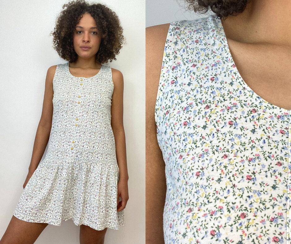 80s Dresses | Casual to Party Dresses 80S Floral Print Dress. 1980S White Flower Sleeveless Pastel Cotton. Medium $0.00 AT vintagedancer.com