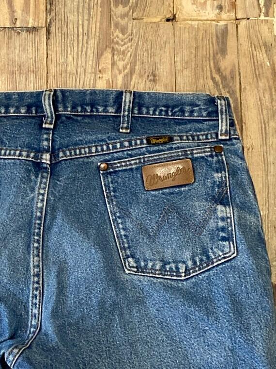 Distressed wrangler jeans
