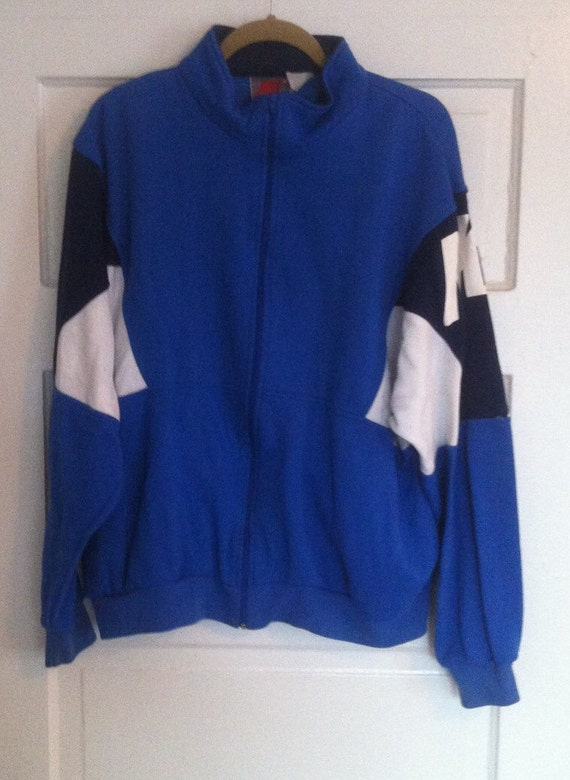 This is a vintage NIKE sweatshirts blue white black size XL Zip up
