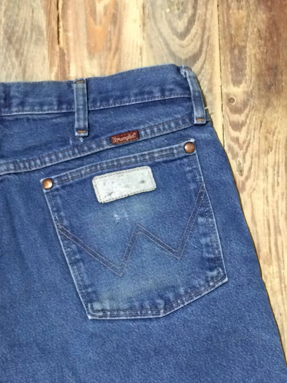 Repaired wrangler jeans