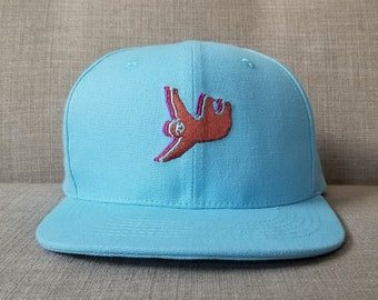 5f371d7d5d1 Sloth Snapback Hat   Carolina Blue Cotton Canvas with Chocolate Sloth