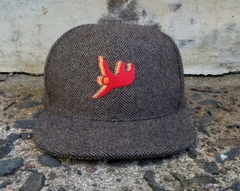 8a3b93d8a64 Sloth Snapback Hat   Pecan Herringbone with Marmalade Sloth