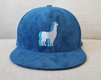 05912309a08 Llama Snapback Hat   Prussian Blue Corduroy with Steel Llama