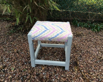 Vintage footstool upholstered in new hand-stitched wool tapestry.
