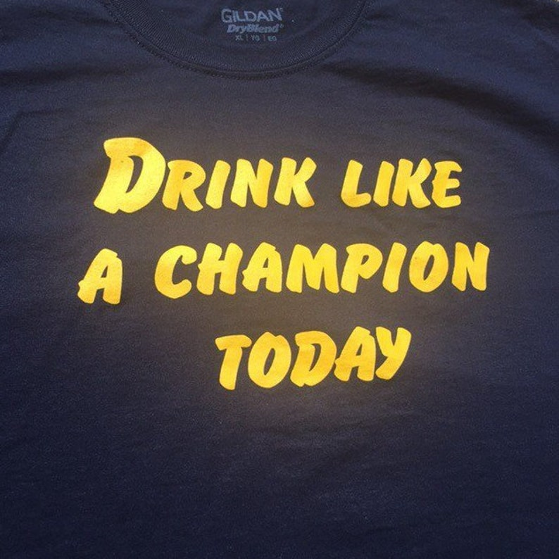 728200f14f41 Drink Like A Champion Today Blue Gold T-Shirt Tailgate Beer | Etsy