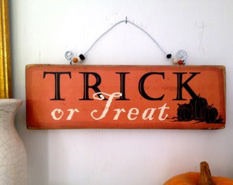 Halloween sign ,Trick or Treat plaque, trick or treat halloween sign,wood halloween sign,shabby chic halloween,beaded halloween sign.