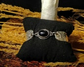 Black Onyx two piece spoon bracelet made of vintage silver plated Silverware.