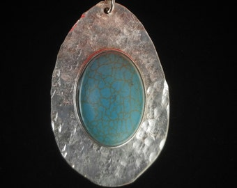Hammered spoon bowl pendant with Turquoise stone. Includes silver chain.
