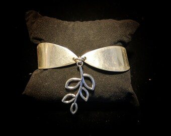 Two piece butter knife bracelet made of vintage silver plated Silverware with leaf branch charm.