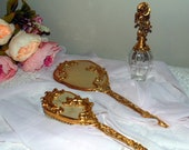 Victorian 24k Gold Plated Hand Mirror w Matching Brush and a Complimenting 7 quot Matson Perfume Bottle w Dauber VERY NICE CONDITION