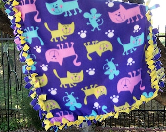 The background is creme with multi-colored cats Small Cat Throw in 100/% Glacier poly fleece What a fun cat throw! Size is 24x 24.