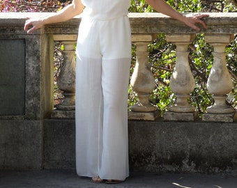 Womens high waist trousers in linen, wool and viscose. White ecru for summer days or for a wedding ceremony. Wide leg trousers