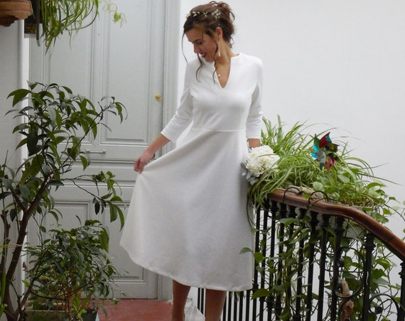 Winter wedding dress, short wedding dress. long sleeves bridal gown. white lace pattern on the fabric. court's house wedding