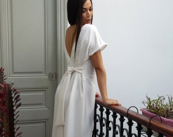 Simple and boho wedding dress with whipped cream lace and plunging V back.