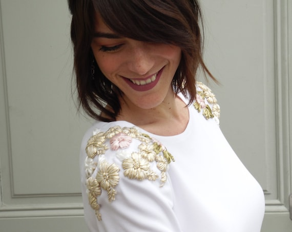 Winter wedding dress with 3/4 sleeves. Simple white dress with floral embroidery at the shoulders