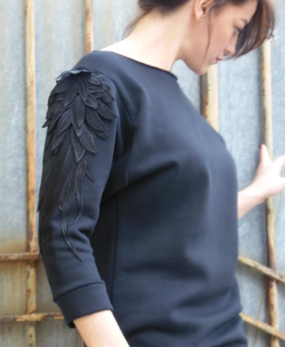 Embroidered sweater, Black sweatshirt, fleece, embroidery application with feathers on the sleeves. sweater with wings. Made in france sweat