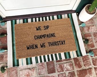 We sip champagne when we thirstay-door mat-door mats-custom door mat-welcome mat-cute door mat-personalized doormat-shop josie b