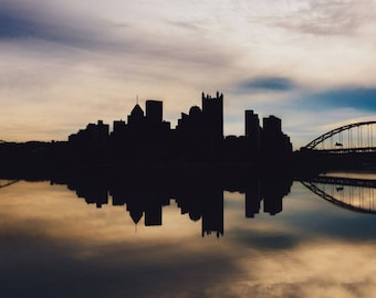 A silhouetted skyline at dawn in Pittsburgh - Various Prints