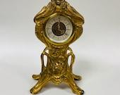 f462 Vintage West Germany Mantel Standing Clock Carved Cupid
