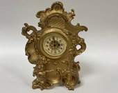 f461 Antique New Haven USA Mantel Standing Clock Carved Cupid