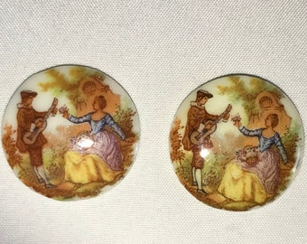 Two 1950s West German 25mm glass cameo cabochon troubadour and colonial lady