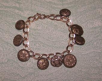 Vintage antique gold antique buttons charm bracelet intricate designs