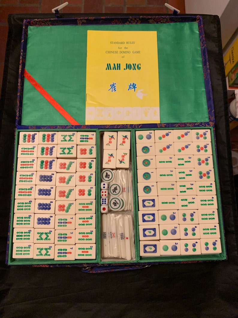photo about Mahjong Rules Printable identify Typical bone and bamboo Mahjong established brocade box