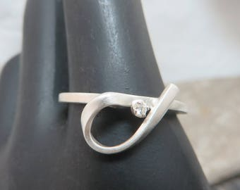 Sterling silver satin with diamond ring