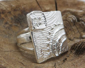 Sterling silver ring with coin cast in cuttlefish bone