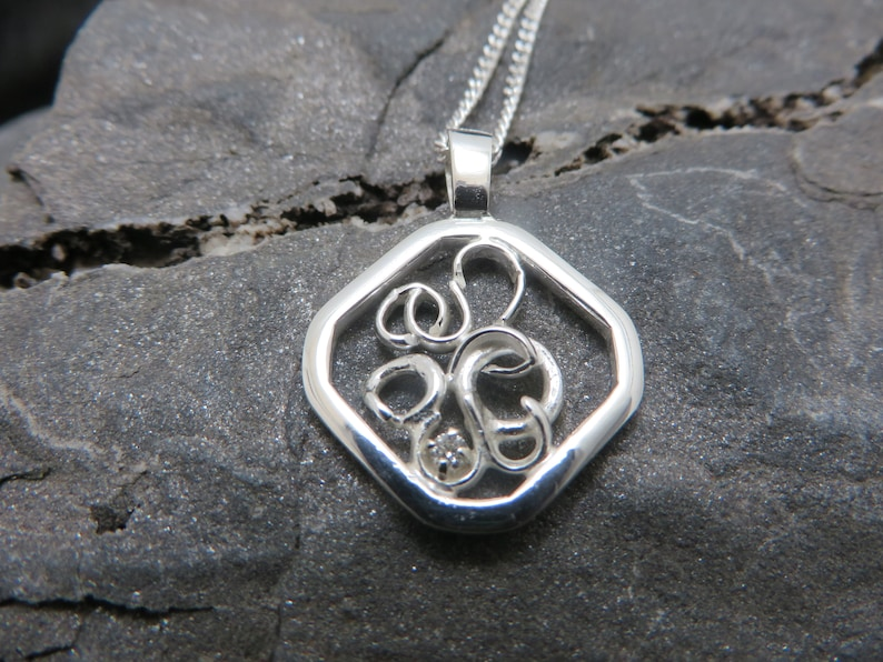 sterling silver pendant set with a diamond on white gold claws