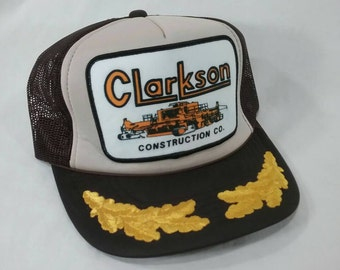 12fc6a9c2a1 Vintage unused Clarkson construction company truckers cap hat brown heavy  machinery