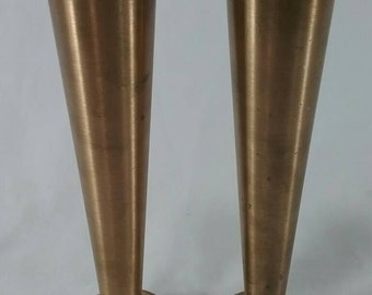 Vintage pair of solid turned metal vases?