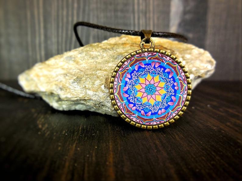 Sacred geometry jewelry with mandala and dharma wheel on image 0