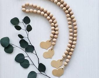 "Natural Wood Bead Garland with Heart - .75"" Diameter"