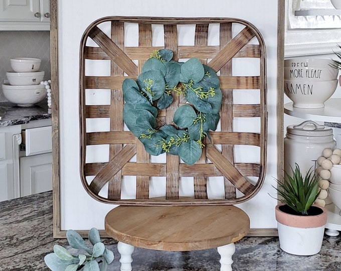 Square Tobacco Basket with Seeded Eucalyptus Wreath.
