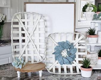 White  Tobacco Basket with Eucalyptus Wreath.