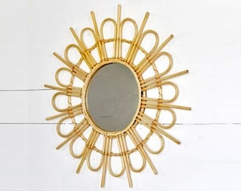"Large 28"" Rattan Sunburst Mirror."
