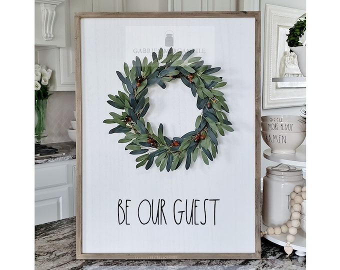"Large White Wash Wood Wall Decor with Olive Leaves Wreath & Hand-Painted ""Be Our Guest"" Sign."