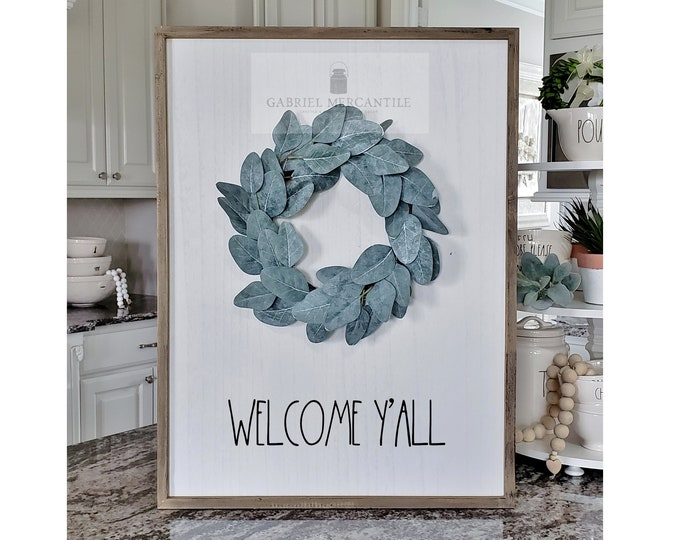 "Large White Wash Wood Wall Decor with artificial Eucalyptus Leaves Wreath & Hand-Painted ""Welcome Y'all"" Sign."