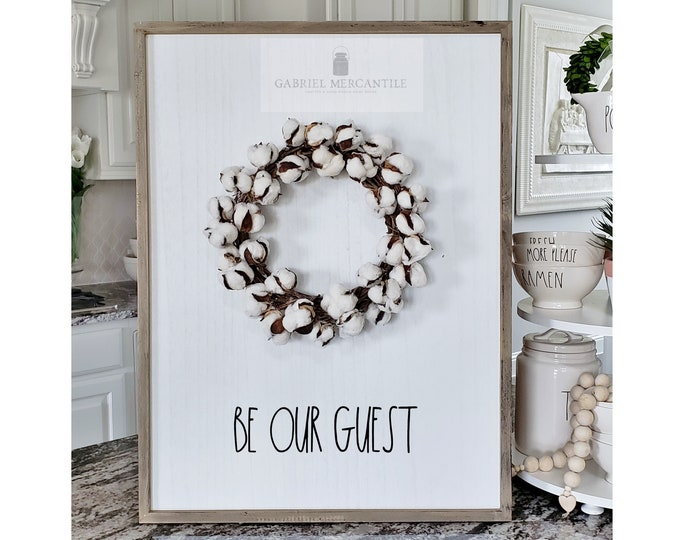 "Large White Wash Wood Wall Decor with Cotton Wreath & Hand-Painted ""Be Our Guest"" Sign."