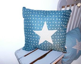 Grey and teal star cushion