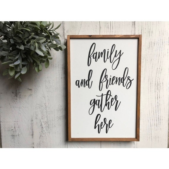 Family and friends gather here - wood sign